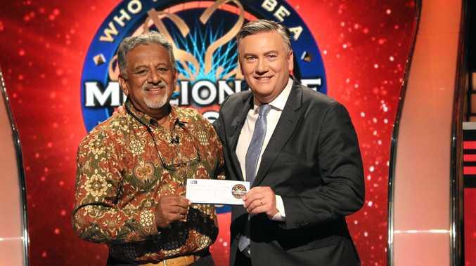 QUIZ MASTER: Krishna Rao (left) receiving a cheque for Ch 9's Eddie McGuire in Millionaire Hot Seat.