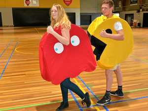 GOOD FUN: Mikayla Hardwick and Ethan Phillips try out adult sized Ghost and Pac-Man costumes, which will be used in live Pac-Man games at Gladstone Pop-Con on April 1 at the Gladstone PCYC.