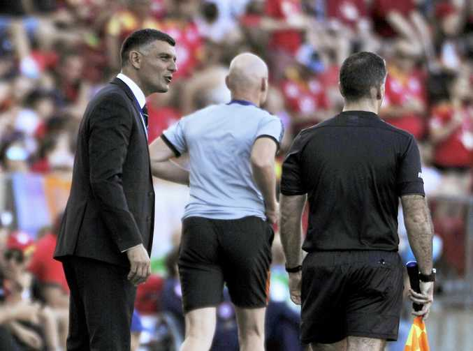 Roar head coach John Aloisi confronts the linesman during the A-League clash against Adelaide United at Coopers Stadium in Adelaide,