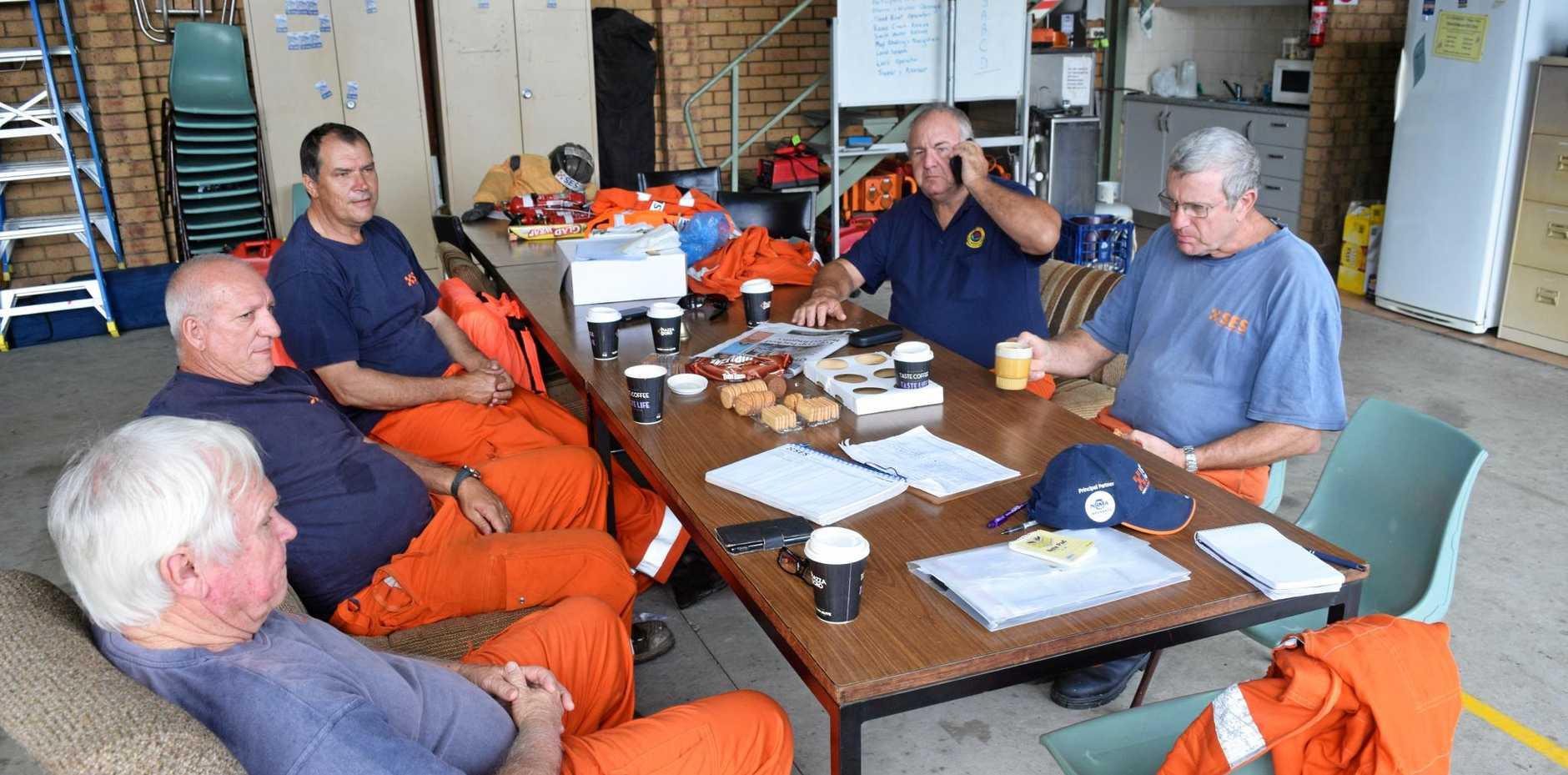 TAKING A BREAK: Woodburn SES Unit volunteers David Rots, Rob Grill, Regan Sawatzki and Jim and Bruce McCormack take a break from flood duty.