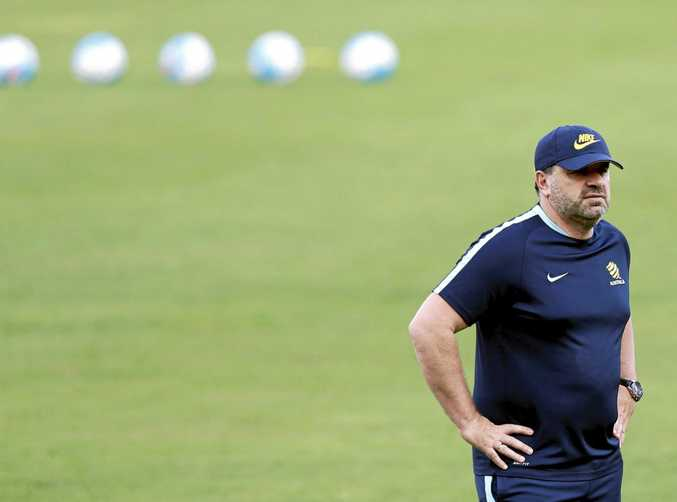 Socceroos coach Ange Postecoglou has slammed the state of the field in Tehran ahead of the World Cup qualifier against Iraq.