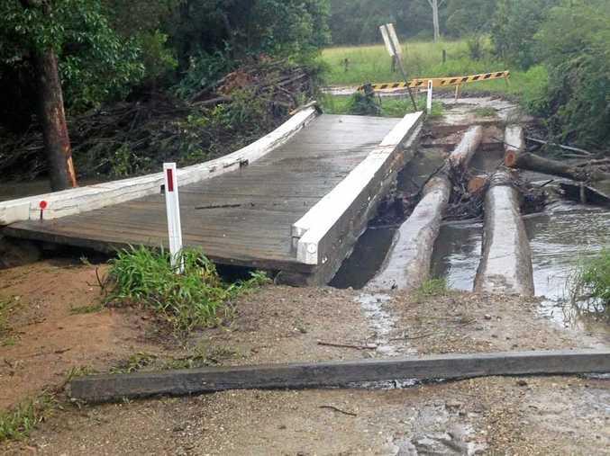 McCellands Bridge, near Nana Glen, pushed off its foundations by flood water.