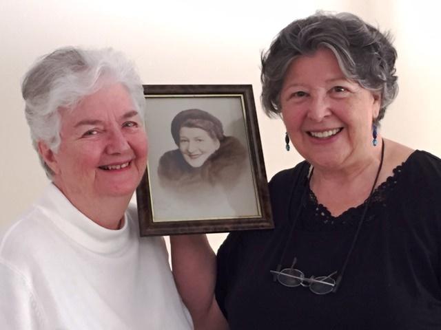 Ros Dunbar-Wells and Leonie Egan with a portrait of Gladys Moncrieff.