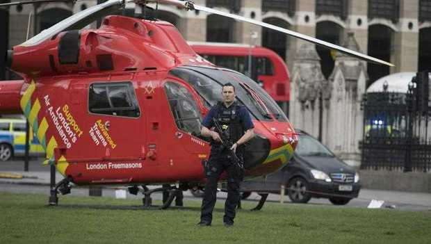 Armed police and an air ambulance following major incidents outside the Houses of Parliament in central London,
