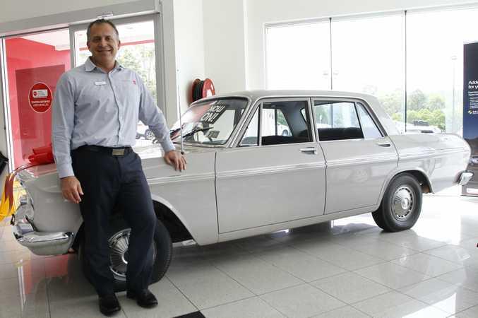 Brett Mills with Ken Mills Toyota Nambour's 1964 Toyota Crown Deluxe.
