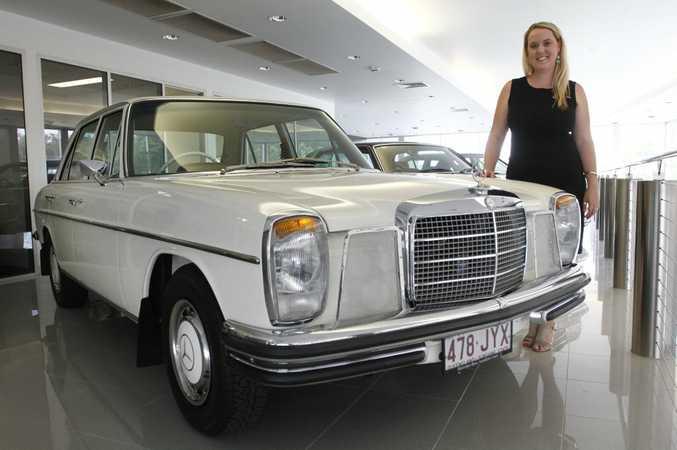 Mercedes-Benz Sunshine Coast's Amelia Gray with the dealership's 1969 Mercedes-Benz 250.