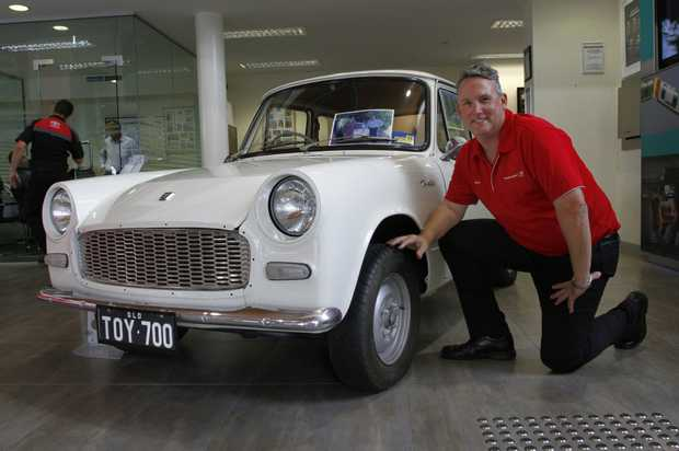 Sales consultant Barry Ramm with Sunshine Toyota Currimundi's 1963 Toyota 700.