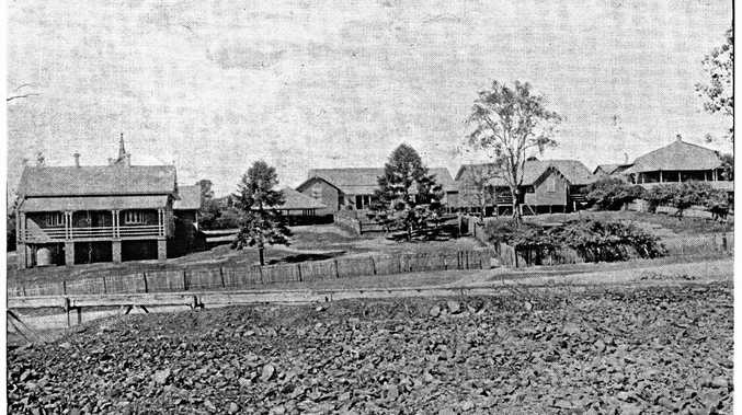 One Mile State School around the early 1890s with the boys' school the middle two buildings, the head teacher's residence top right and girls' school on the left.