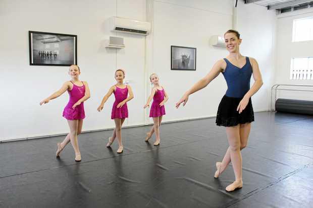 Dance teacher Alex Davis with Emerald Academy of Dance students Saphron Davis, Matilda Kerr and Charlee Howard.