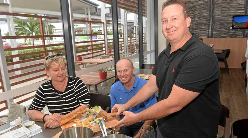 Rosmarie Fornaro-Widmer from the Grasstree Beach Mango Farm and Rod Bauman from Freckle Farm are offered a tasting platter by Ibis general manager Scott Grant.