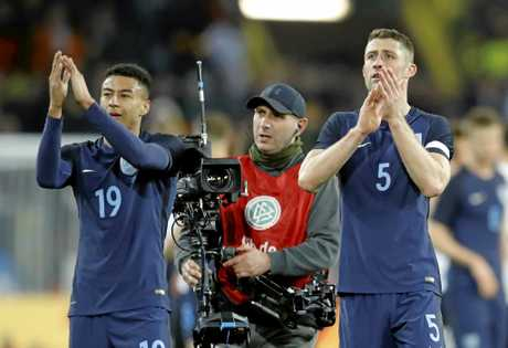 England's Jesse Lingard, left, and Gary Cahill acknowledge the spectators in Dortmund, Germany