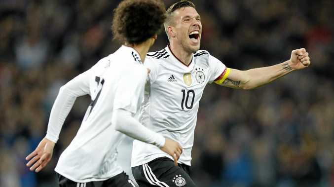Lukas Podolski (R) of Germany celebrates with teammate Leroy Sane after scoring