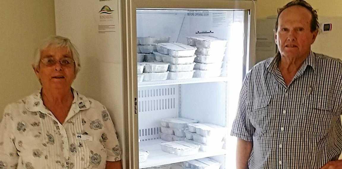 COOL NEWS: Kay Rieck and John Goodman with the new fridge.