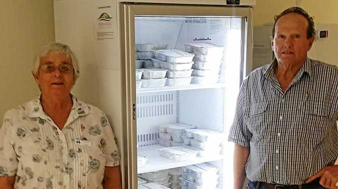 COOL NEWS: Kay Rieck and John Goodman with the new fridge.