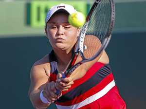 Ashleigh Barty of Australia in action against Eugenie Bouchard of Canada at the Miami Open.