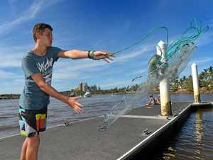BIG THROW: Harry Mathews tries his luck with his cast net.