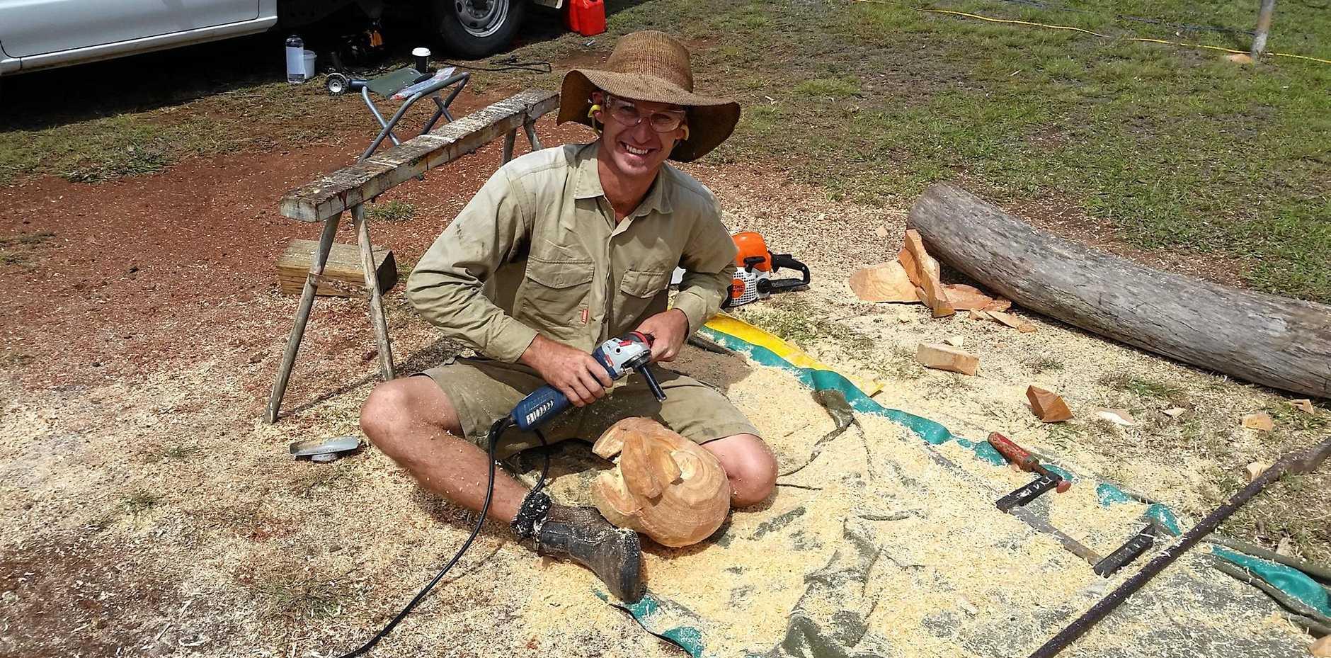 UNIQUE TALENT: Shane Christensen creating sculptures at the Blackbutt Avocado Festival 2016