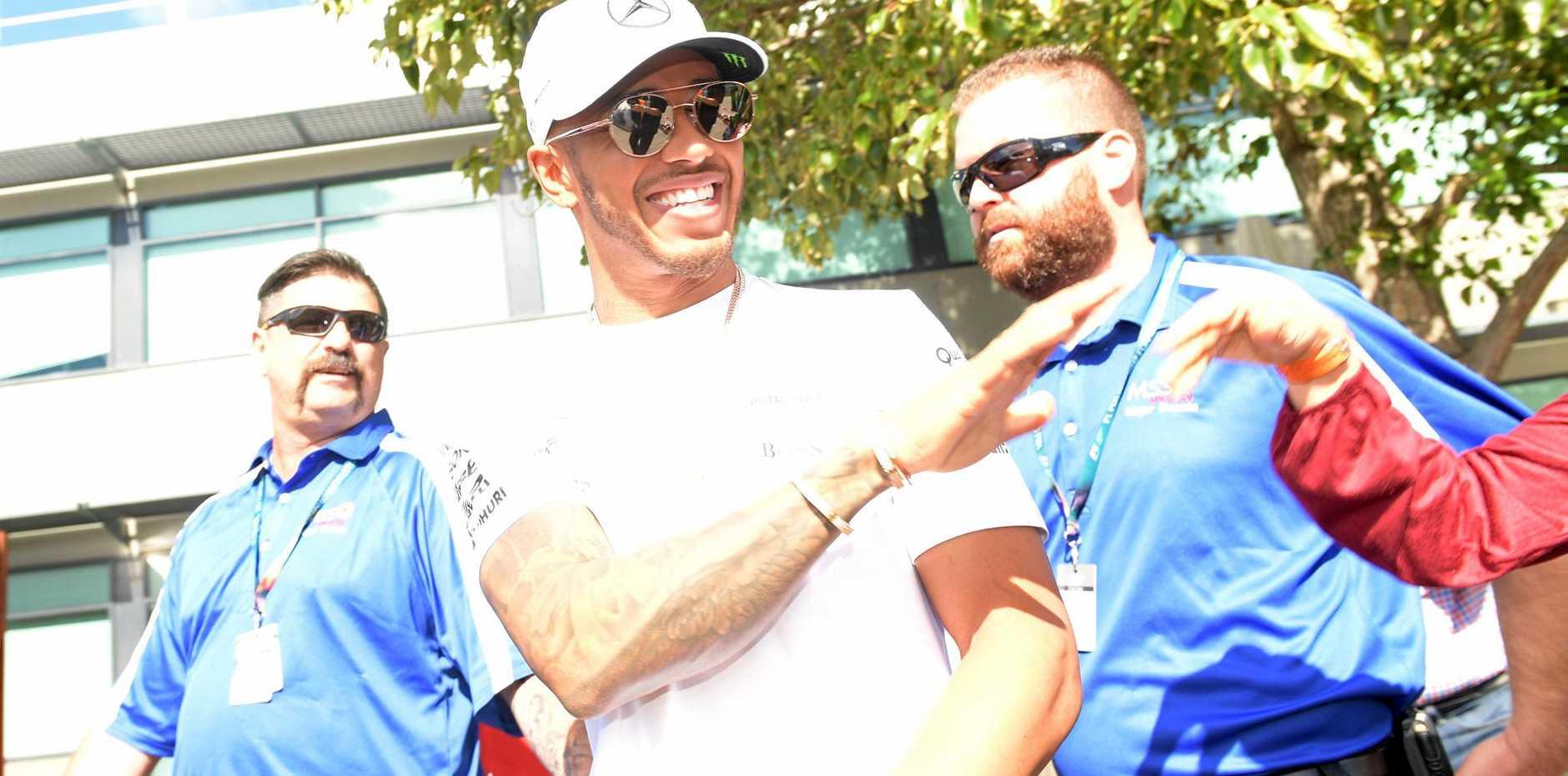 Lewis Hamilton arrives for an Australian Grand Prix qualifying session at Albert Park.