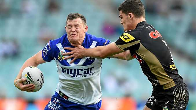 Brett Morris of the Bulldogs is tackled by Nathan Cleary of the Panthers.