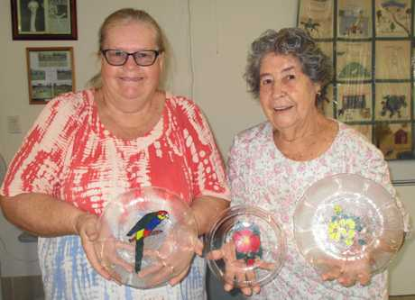 Judy Houben and Audrey Fort with a selection of glass paintings from Wednesday.
