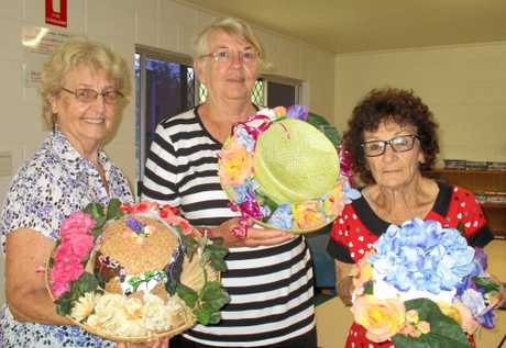 Alice Burke, Colleen Hore and Marilyn Belford with some of the hats decorated for this year's Australia's Biggest Morning Tea to be held at the Bushman's Bar on May 24.