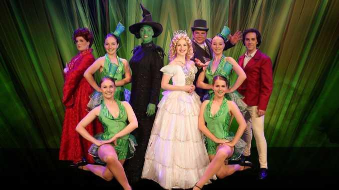 Ready to raise the curtain on Wicked are cast members (from left) Joanna Pearson (Madame Morrible), Taylor Seymour (Ensemble), Louise Fraser (Elphaba), Shannon Gralow (Glinda) , Brad Boyton (The Wizard), Eden Barker (Ensemble) Justin Tamblyn (Fiyero) , Eve Murphy (Ensemble) , Lucinda Panitz (Ensemble).