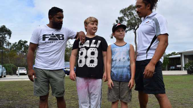 HERE FOR YOU: Titans legend Preston Campbell (L) with Tate Bettles, 11, Kaleb Bettles, 9 and NRL star Clinton Toopi in Hervey Bay.