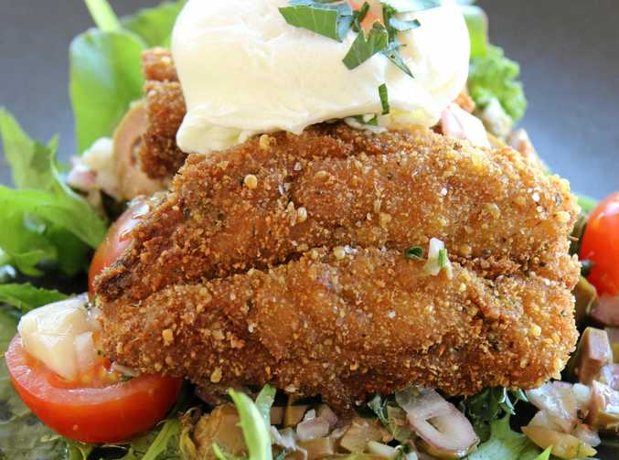 Crumbed sardines with poached egg, olive salsa and rocket.