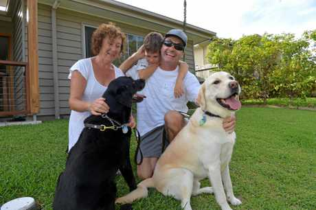 Robin Braidwood with his wife Marian, son Kyte, guide dog Siggy and retired guide dog Narjee.