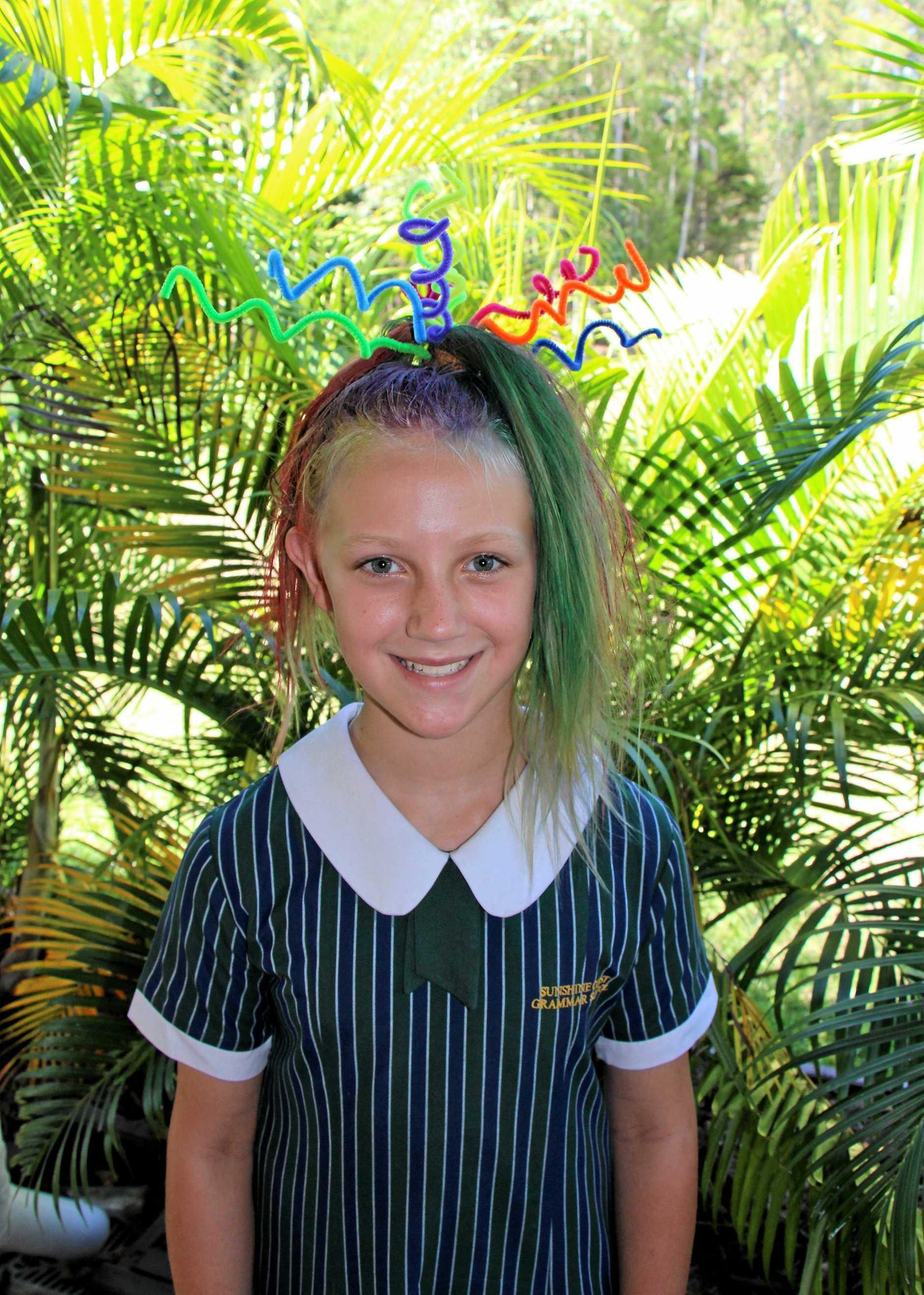 Sunshine Coast Grammar student Bella Morris with a full head of hair.