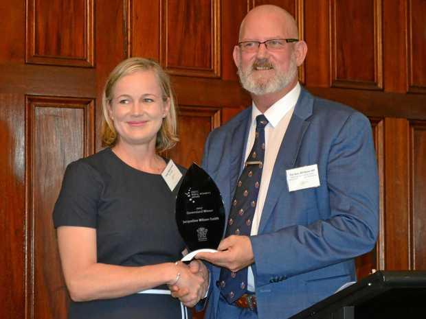 2017 Queensland Rural Women's Award winner Jacqui Wilson-Smith accepting her award from Minster Bill Byrne in Brisbane.