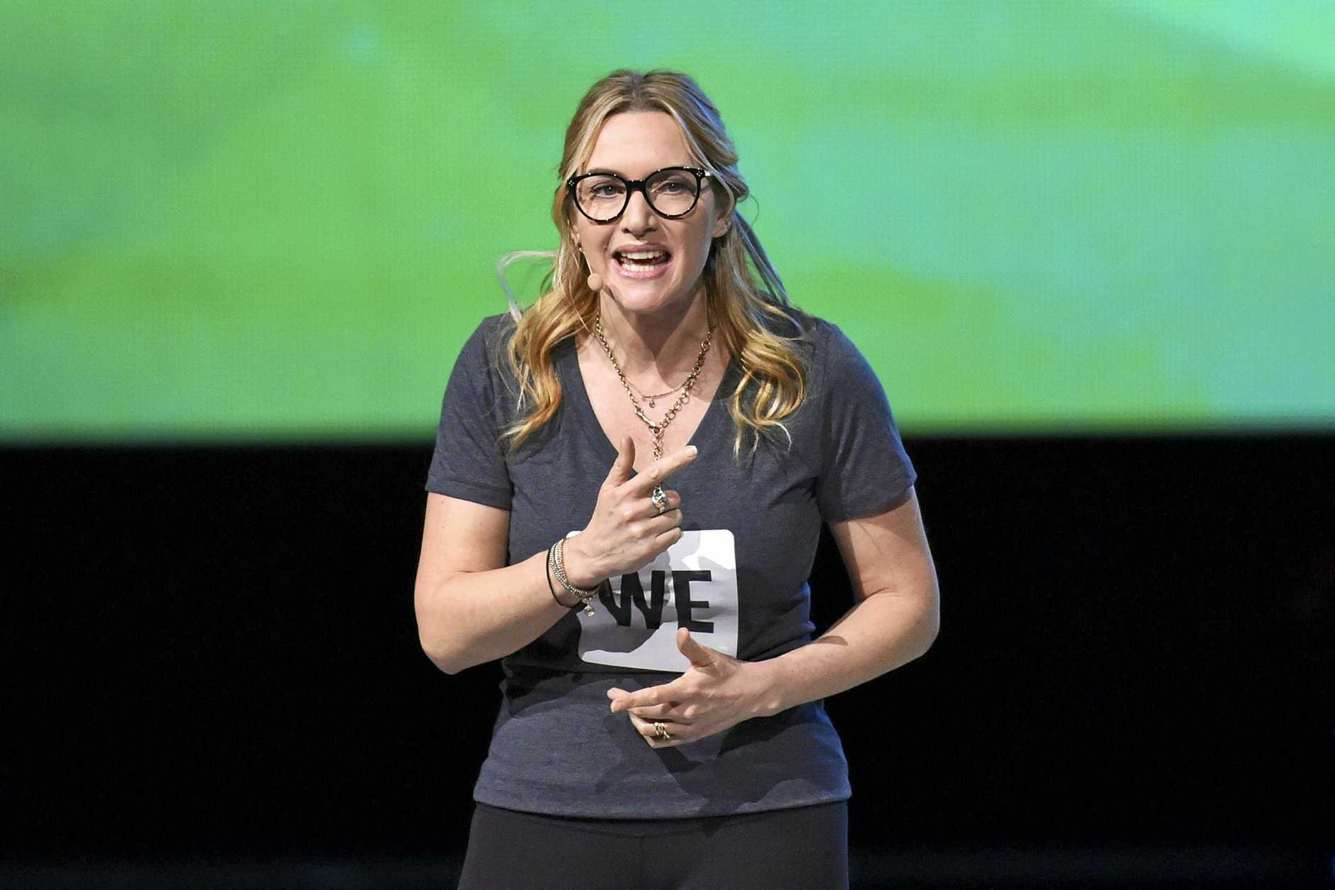 British actress Kate Winslet gestures on stage at the WE Day UK charity event and concert in London.