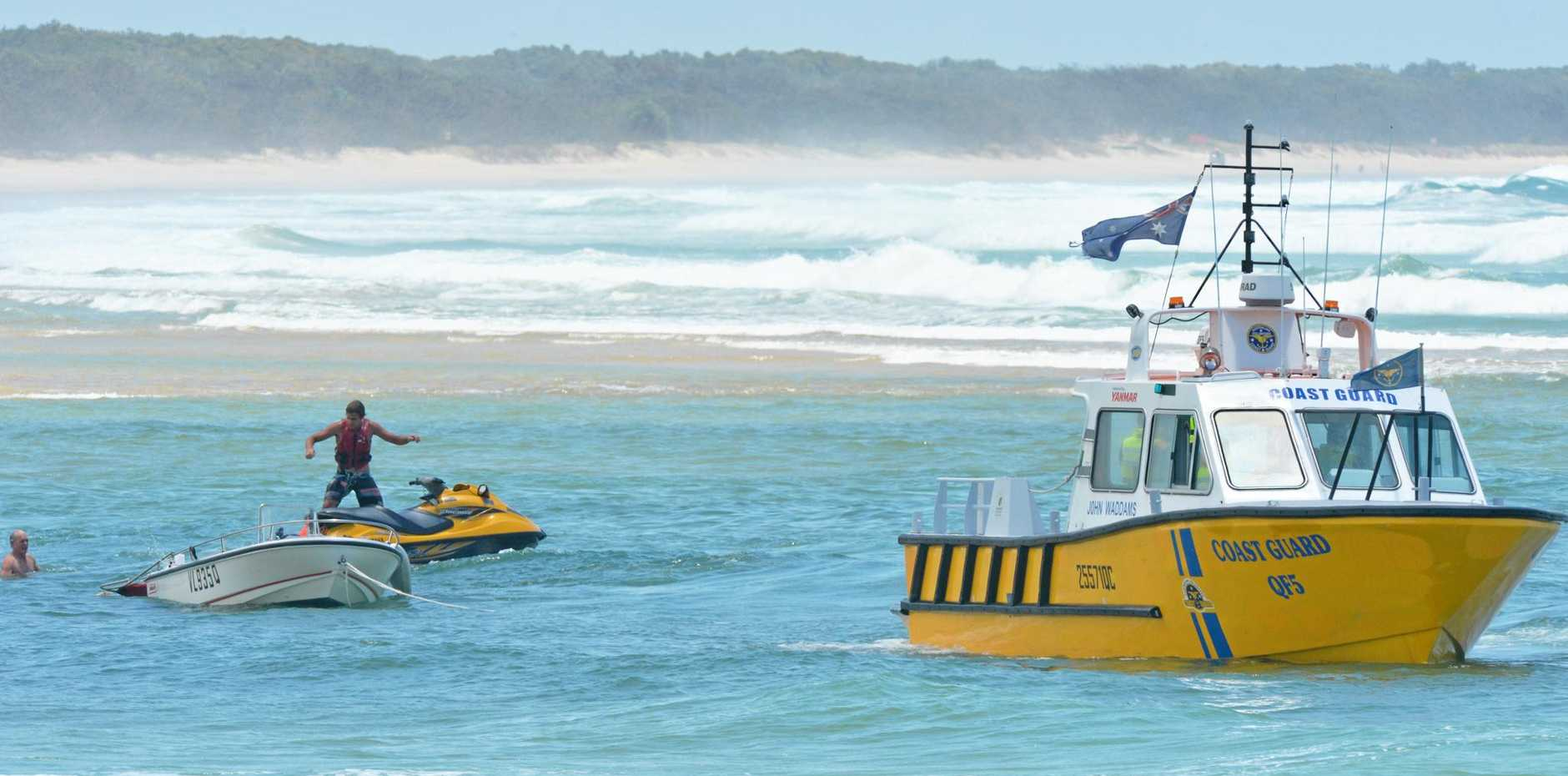 FLASHBACK: Two boats capsized on Noosa bar. Police and Coastguard were on scene in 2012 to assist.
