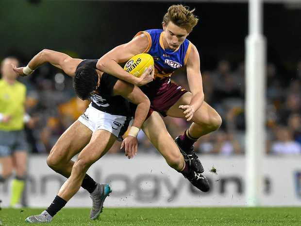 Harris Andrews of the Brisbane Lions (right) in action.