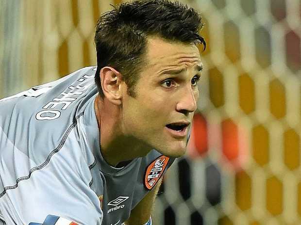 Roar keeper Michael Theo.