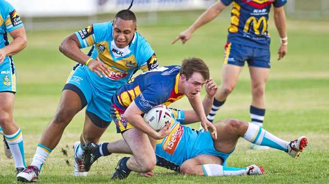 Western Mustangs' Jackson Shelswell is collared by the Gold Coast defence in an under 20 trial match last month.
