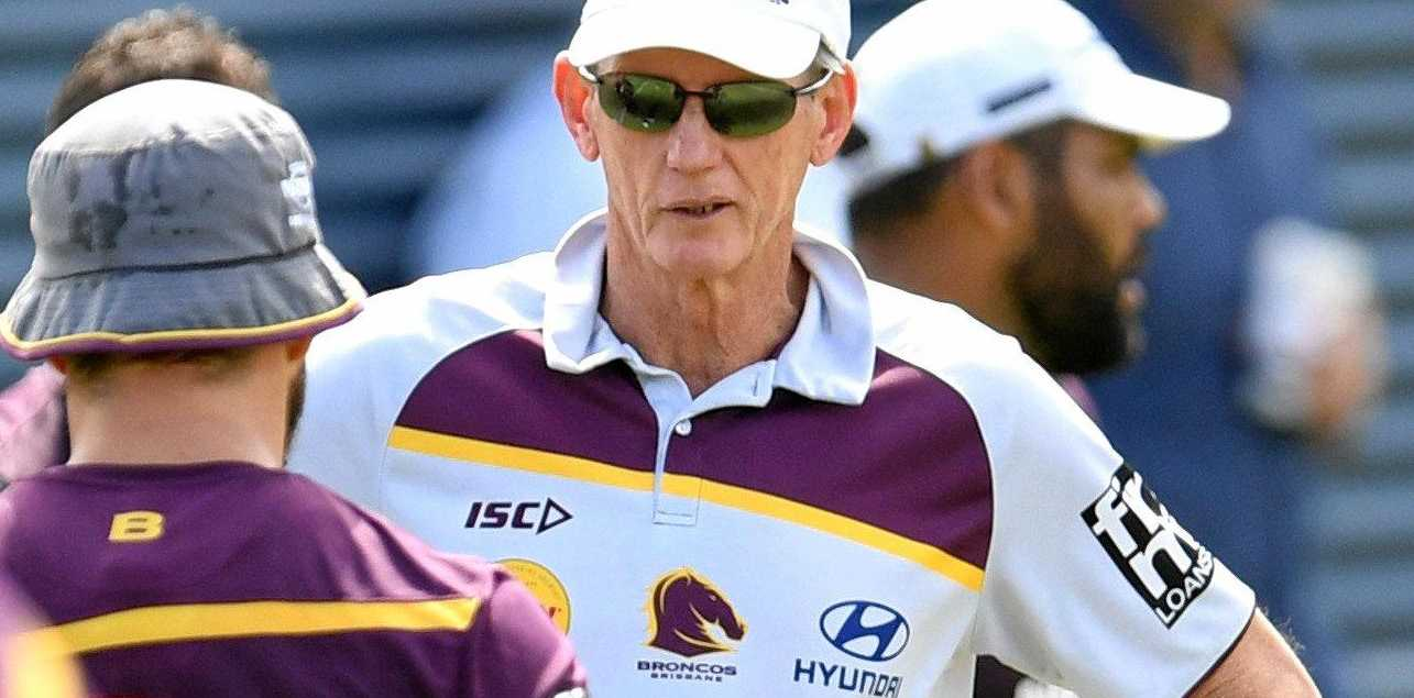 Brisbane Broncos coach Wayne Bennett talks to his players during training at Red Hill.