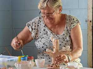 Thelma Lake paints a piece of hand built pottery at Pioneer Potters.