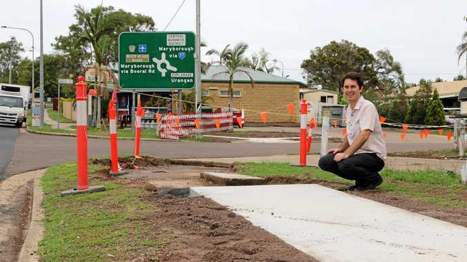 Cr Seymour inspects progress of footpath works on Boat Harbour Drive between Riley Street and the Esplanade.