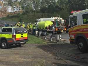UPDATE: Trucks jammed on bridge, firies cut driver out