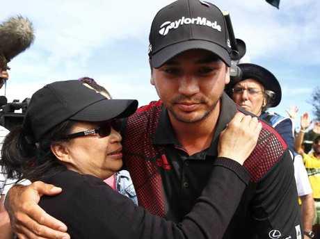 Jason Day hugs his mum Dening.