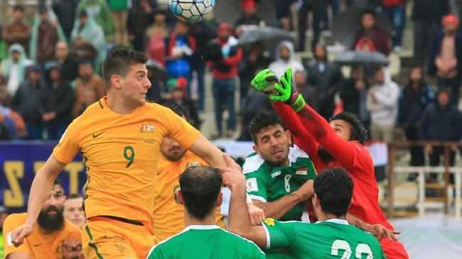 Tomi Juric goes up for a header during the Socceroos v Iraq World Cup Qualifier.