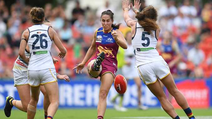 Sharni Webb of the Brisbane Lions (centre) kicks during the AFLW Grand Final game against the Adelaide Crows at Metricon Stadium in Carrara on the Gold Coast, Saturday, March 25, 2017.