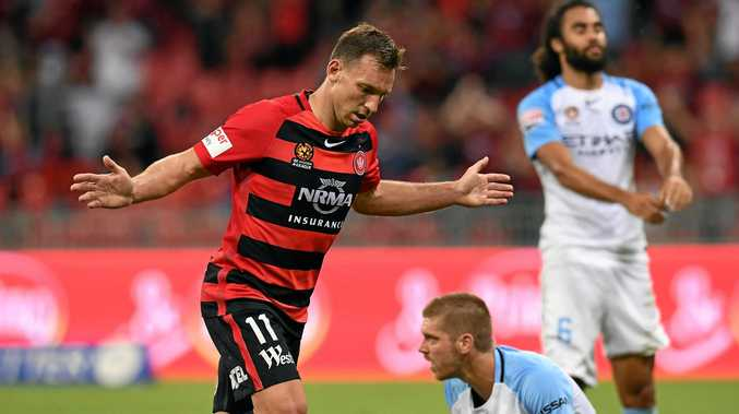 Brendan Santalab celebrates his second goal for the Wanderers during the round 24 A-League match against Melbourne City at Spotless Stadium in Sydney.