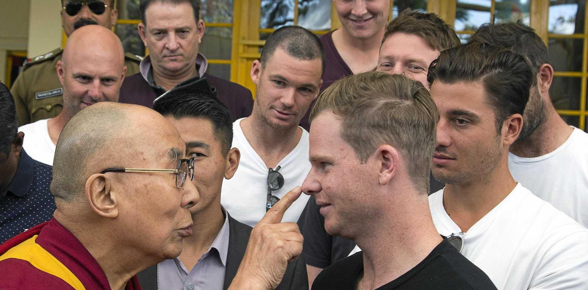 Tibetan spiritual leader the Dalai Lama (left) touches the nose of Australian cricket team captain Steven Smith in Dharmsala.