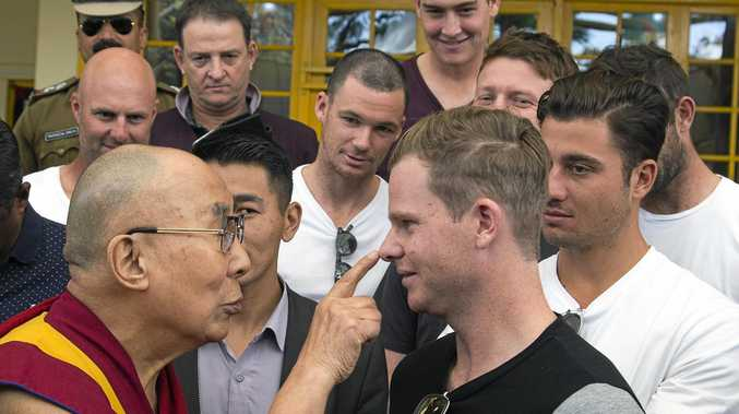 Tibetan spiritual leader the Dalai Lama (left) touches the nose of Australian cricket team captain Steven Smith in Dharmsala.