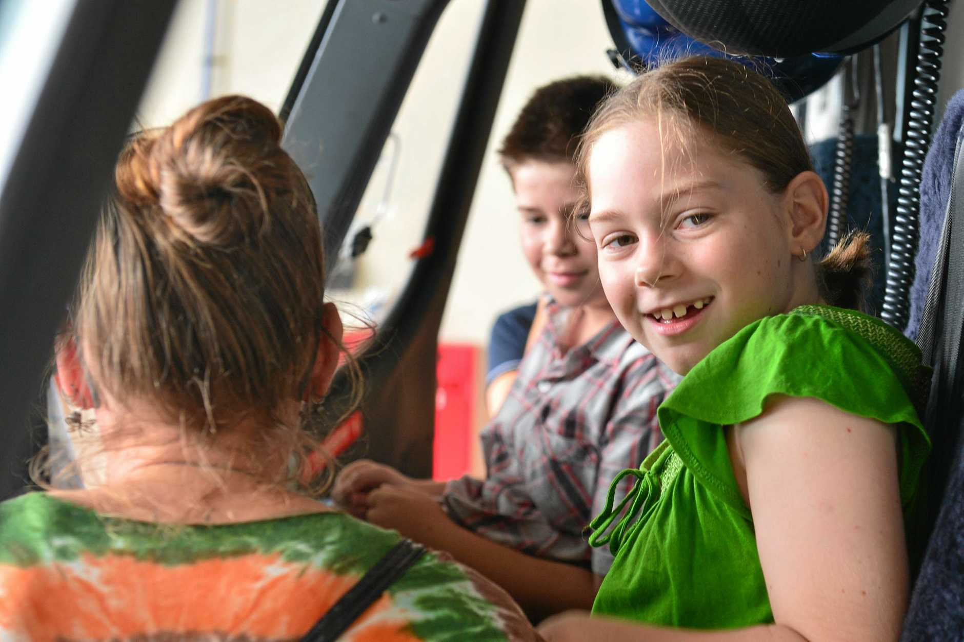 Gympie mother, Kate Bailey thanks LifeFlight for saving her two children Aneeka and Cooper Bailey-Bauer in an emotional reunion at the Sunshine Coast helicopter base.