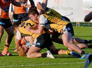 MUSCLE: The Falcons muscle up in defence against Easts in Round 1.