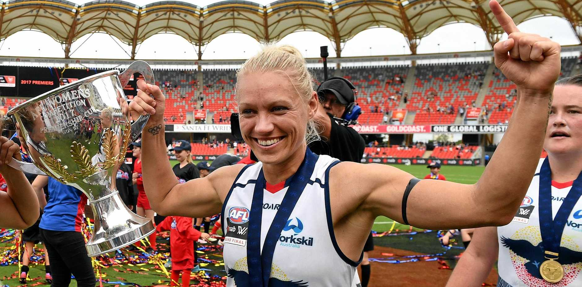 Adelaide Crows co-captain Erin Phillips celebrates winning the AFLW grand final against the Brisbane Lions at Metricon Stadium.