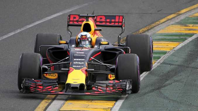 Red Bull driver Daniel Ricciardo of Australia steers his car during qualifying for the Australian Grand Prix in Melbourne.